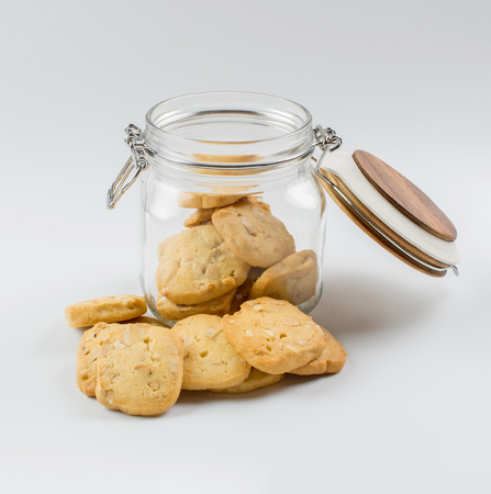 Homemade cookies with a glass jar on white background. 스톡 콘텐츠
