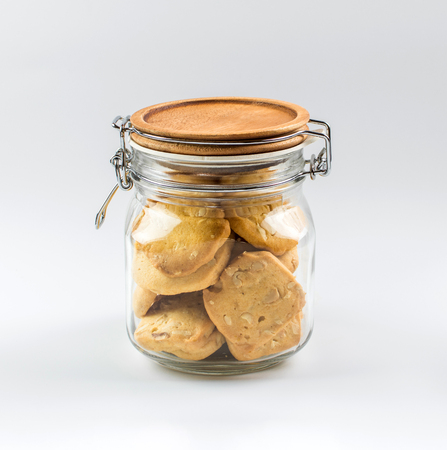 Homemade cookies in a glass jar on white background. 스톡 콘텐츠