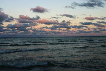 huron: Sunset on Lake Huron, Michigan.  Waves and pink clouds create a beautiful shot