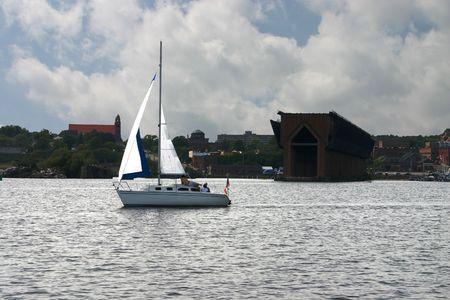 marquette: Sailboat in Marquette Harbor, Michigan.  Old Ore Dock in background