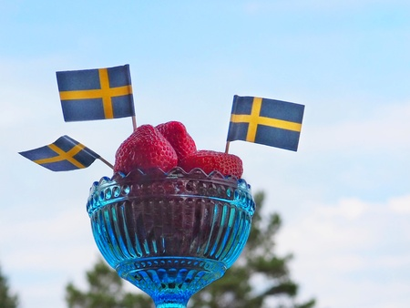 Strawberries with swedish flags for Swedens National Day or Midsummer