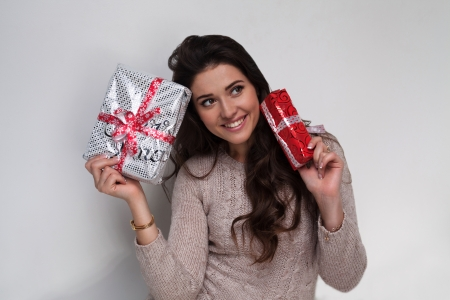 Beautiful girl with two christmas presents in beige sweater Stock Photo - 22578172