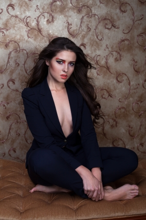 Sexy girl in black suit with colorful eyeshadow photo