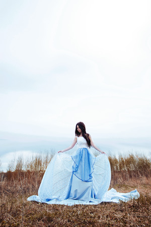 Girl in long blue dress photo