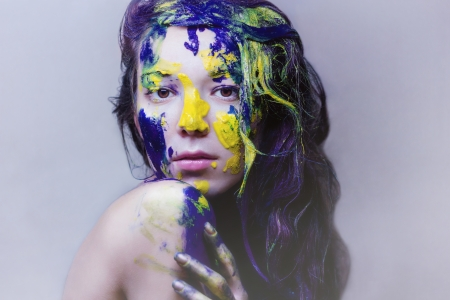Beauty portrait of a girl painted blue and yellow photo