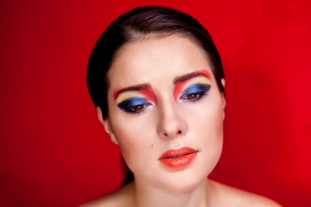 Beauty portrait of a girl with colorful make up photo