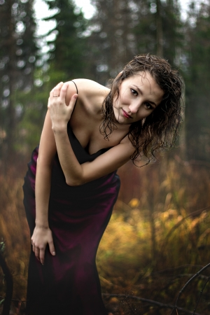 Portrait of woman im purple dress under rain photo