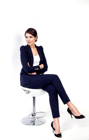 sitting chair: Happy successful business woman in office chair on white  Stock Photo