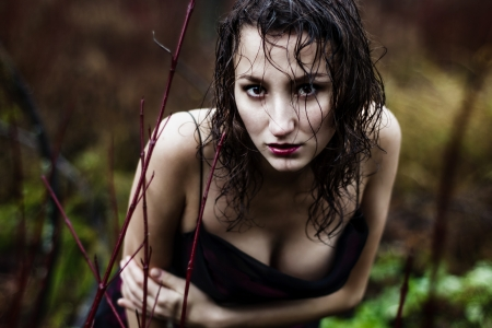 Wild woman s face under rain photo