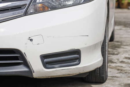 crashed car Front bumper cover with cracks. Stock Photo