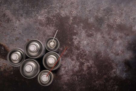 set of color spray bottles or car polish spray on Concrete background ,With space for text
