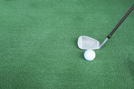 Golf clubs and golf balls on green artificial grass At the golf driving range Reklamní fotografie
