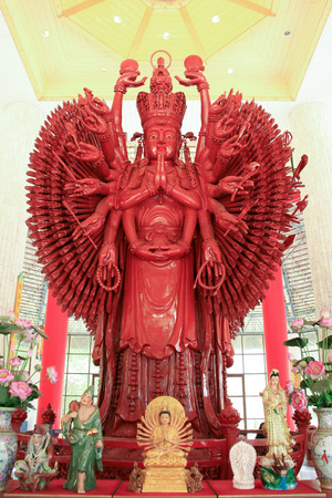 Big red wooden thousand hands Guan Yin