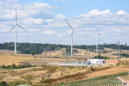 Wind turbine electrical power plant on a mountain, wind turbines farm, wind power plant with blue sky background