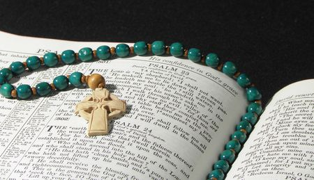 Rosary Prayer Celtic Beads on Large Open Bible photo