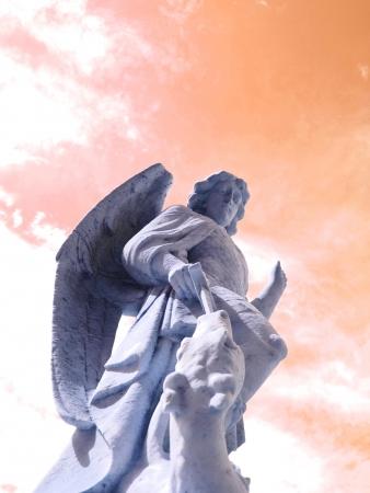 White Angel Slaying Dragon Against Red Sky Stok Fotoğraf - 14670663