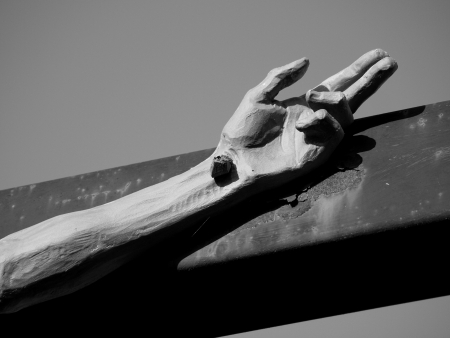 hand: Hand of Jesus Christ Nailed Hand to Cross Closeup; Hand with Trinity Symbol