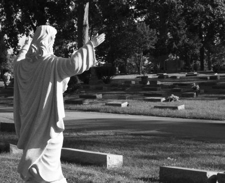 Jesus Raises Hands in Blessing in Cemetery