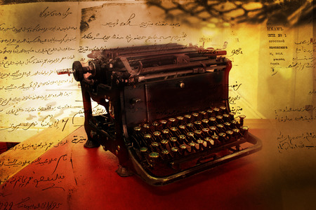 copy machine: black vintage typewriter with empty white page on working table, retro toned