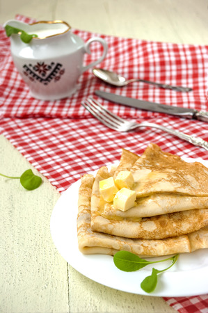 Pancakes stack with sour cream, traditional Russian