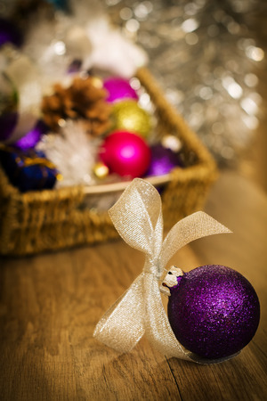 Shiny purple ball for the Christmas tree on a wooden background photo