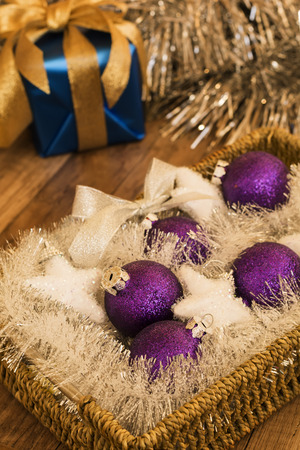 Shiny purple balls for the Christmas tree on a wooden background photo
