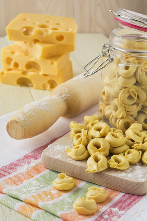 Italian traditional raw tortellini with cheese for cooking.Selective focus. photo