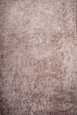 Beige wool sheepskin texture background. Top view. Copy space.