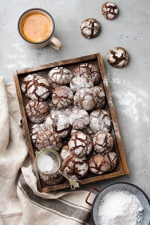 Chocolate brownie cookies in powdered sugar. Chocolate Crinkles.