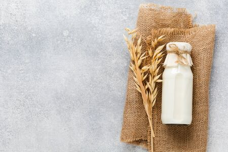 Homemade diet vegetable milk made from oatmeal on a gray background. Diet healthy concept. Copy space and Banner.Top view.