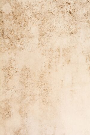 Light brown stone or slate wall. Grunge background. Top view