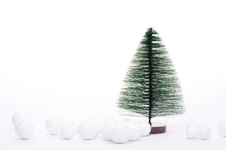One tiny Christmas trees isolated on white.