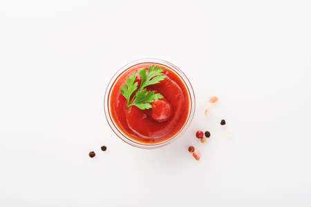Tomato ketchup tasty in bowl isolated on white. Mock up. Isolated on white background.