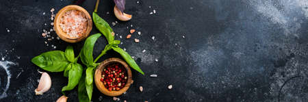 Ingredients for making traditional italian pesto sauce on old dark rustic background. Flat lay. Foto de archivo