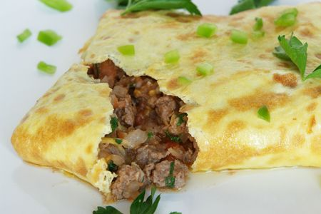 One Stuffed Thai Omelette on white plate