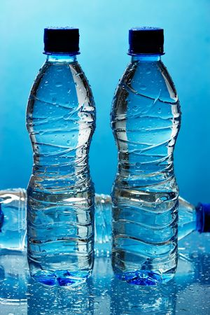 Water bottles on blue background Stock Photo - 441557
