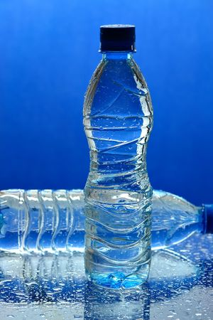 Water bottles on blue background Stock Photo