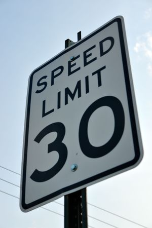 streetsign: Speed Limit thirty sign with sky in the background