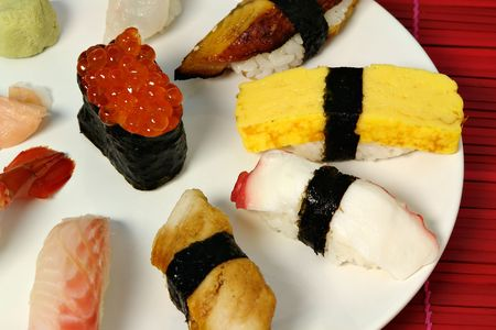 A selection of nigiri sushi on plate photo