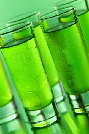 rich flavor: Green shots on a green background Stock Photo