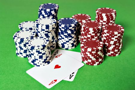 Pocket Aces and poker chips on a game table photo