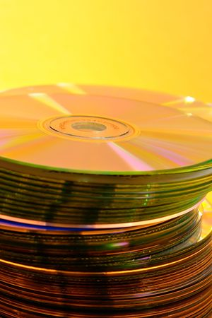 Stack of Cds on yellow background