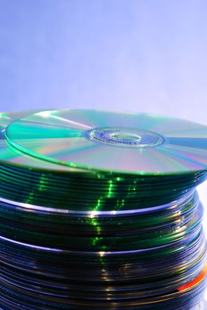 cds: Stack of Cds on blue background