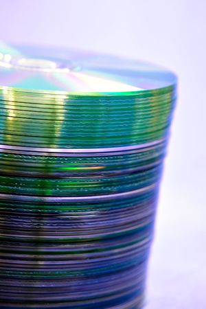 Stack of Cds on blue background