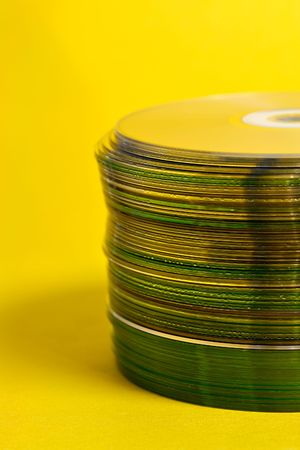 cds: Stack of Cds on yellow background