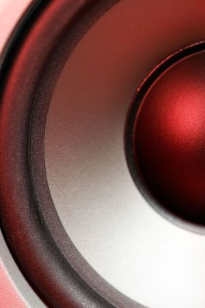 Speaker close up with red reflection Stock Photo