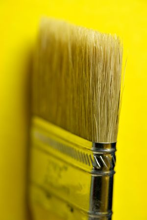 flat brush: Flat brush on yellow Stock Photo