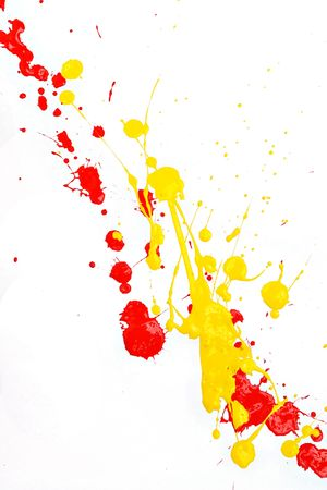 Red and yellow paint splashed on white background
