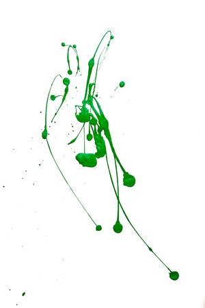 Green paint splashed on white background photo