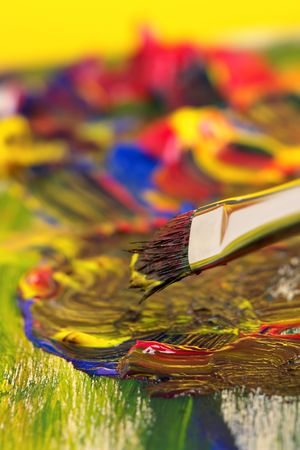 Mixing paint with brush on wood Stock Photo - 640764
